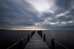 Long exposure of a Currituck Sound pier with motion blurred clouds. - North Carolina (Outer Banks)