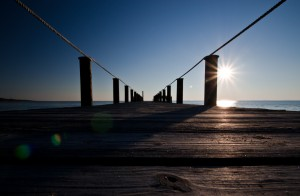 A pier extends into the Currituck Sound in the late-day sun - North Carolina (Outer Banks)