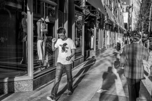 Young man walking toward the glaring sun - Philadelphia Street Photography