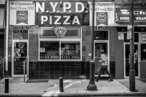 Passerby looking through the door at NYPD Pizza - Philadelphia Street Photography