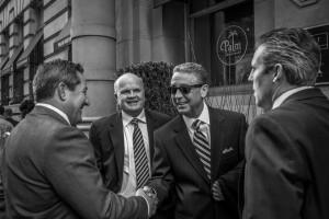 Businessmen shaking hands outside the Palm Restaurant in Philadelphia