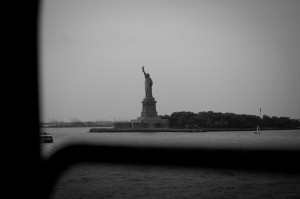 The Statue of Liberty, as seen through a Staten Island Ferry window.